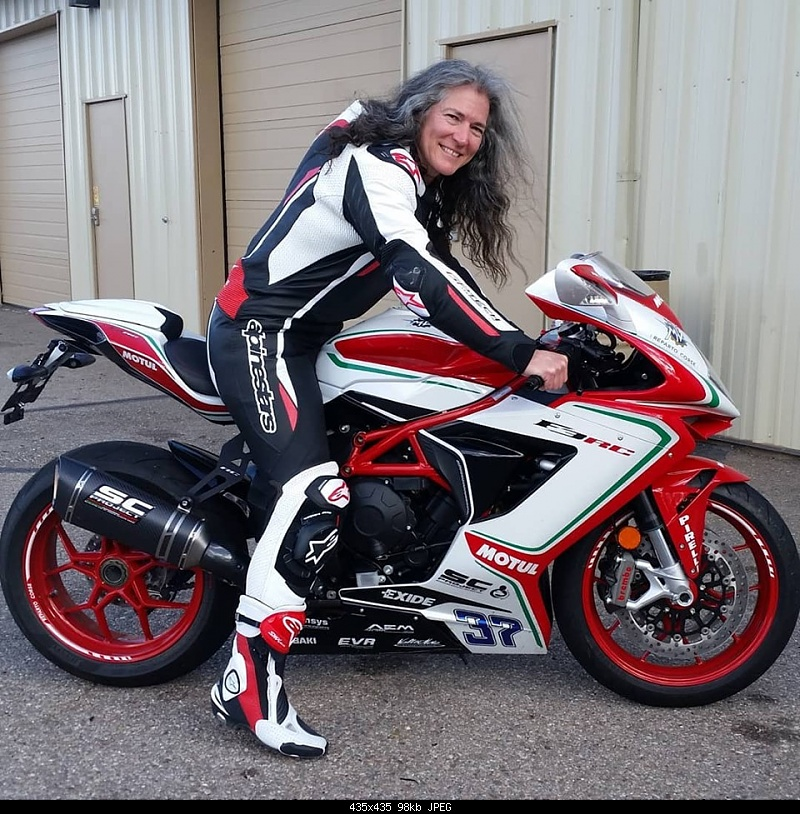 Click image for larger version.  Name:Andie on bike.jpg Views:13 Size:98.4 KB ID:382236